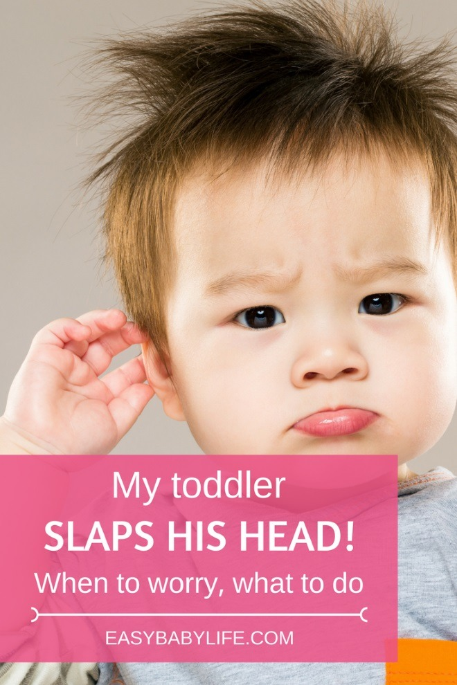 toddler baby hits side of head with hand