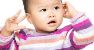 why babies hit themselves