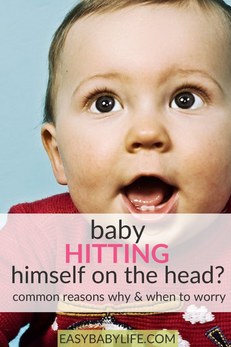 baby is hitting himself in the head